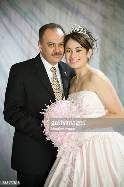 Father and Daughter Posing for Quinceanera Portrait