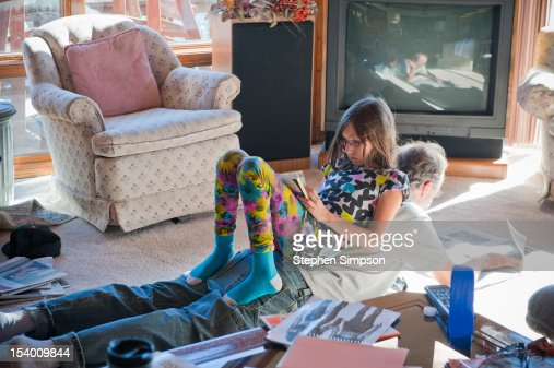 Father and daughter reading on living room floor