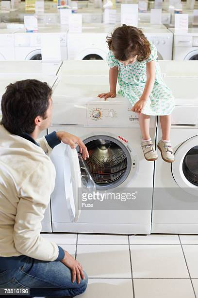 Father and Daughter Shopping for Laundry Machines