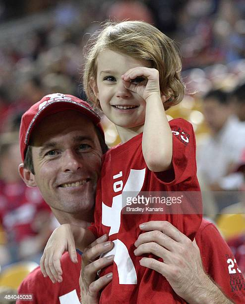 Father and daughter show their support for the Reds during the round nine Super Rugby match between the Reds and the Brumbies at Suncorp Stadium on...