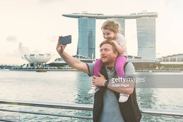 Father and daughter taking selfie in Singapore