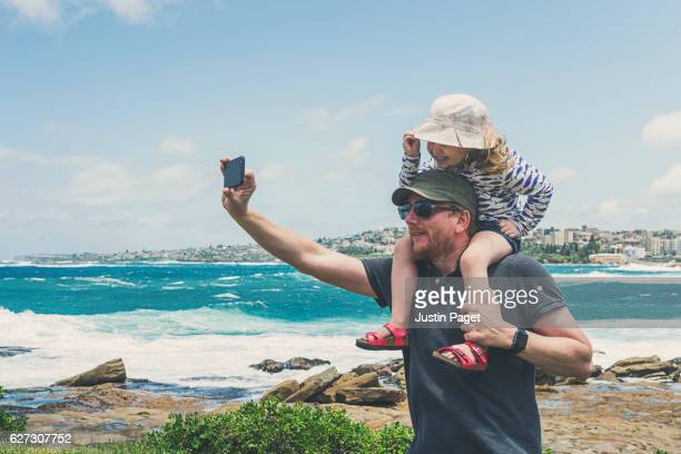 Father and Daughter taking selfie on Sydney shores