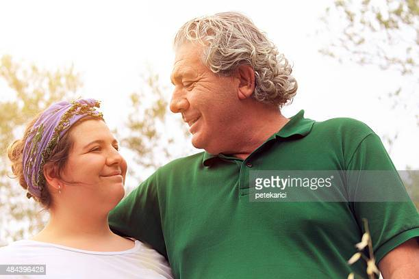 Father and Daughter Talking In Nature