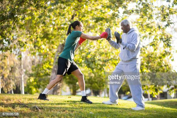 Father and Daughter Training Boxing