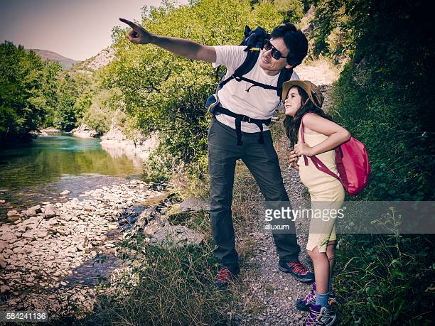 Father and daughter trekking in nature