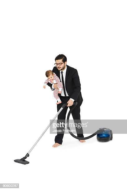 Father and daughter vacuuming.