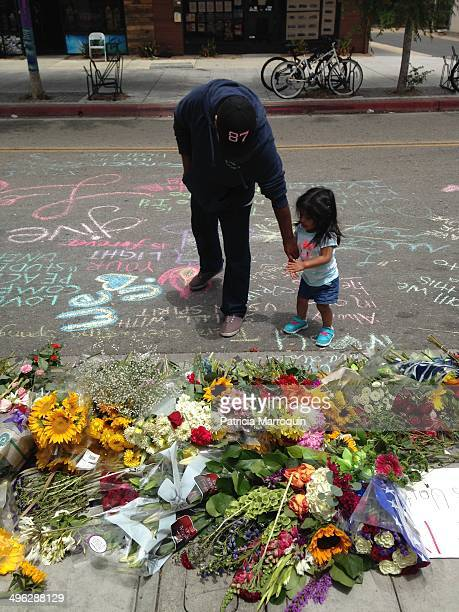 A father and daughter view a makeshift memorial set up in front of the IV Deli Mart in Isla Vista California At this site Elliot Rodger shot and...