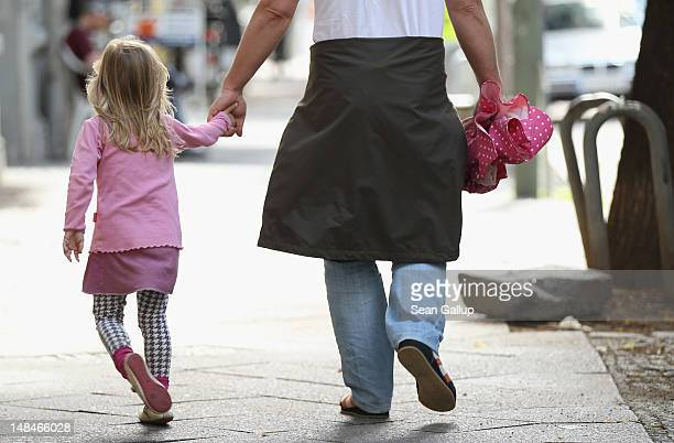 A father and daughter walk in the city center on July 17 2012 in Berlin Germany The German government recently passed a new law that will guarantee...