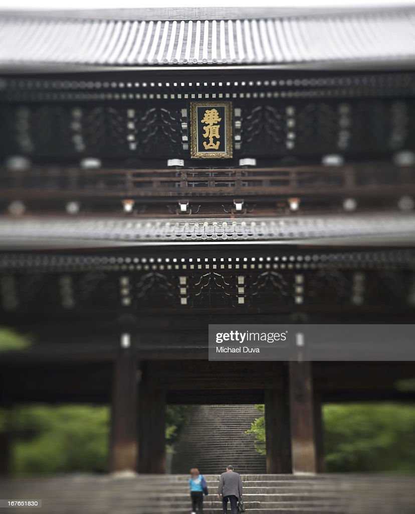 father and daughter walk the steps temple gate : Stock Photo