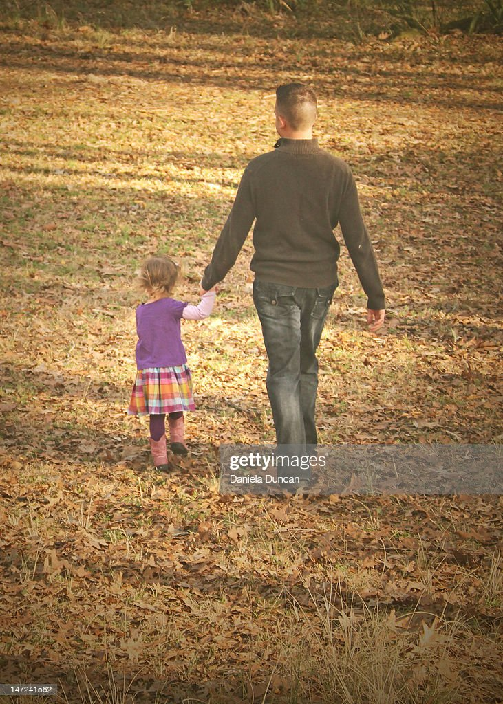 Father and daughter walking : Stock Photo