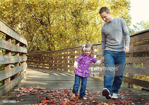 Father and daughter walking together outdoors