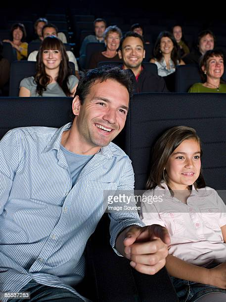 A father and daughter watching a movie
