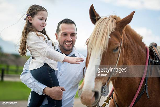 Father and daughter with a horse