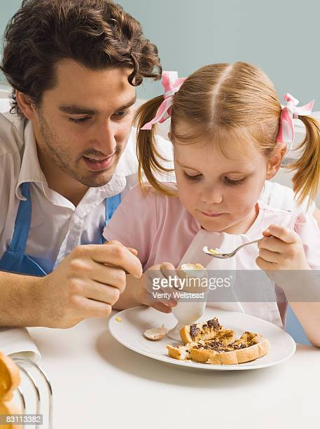 Father and daughter with breakfast