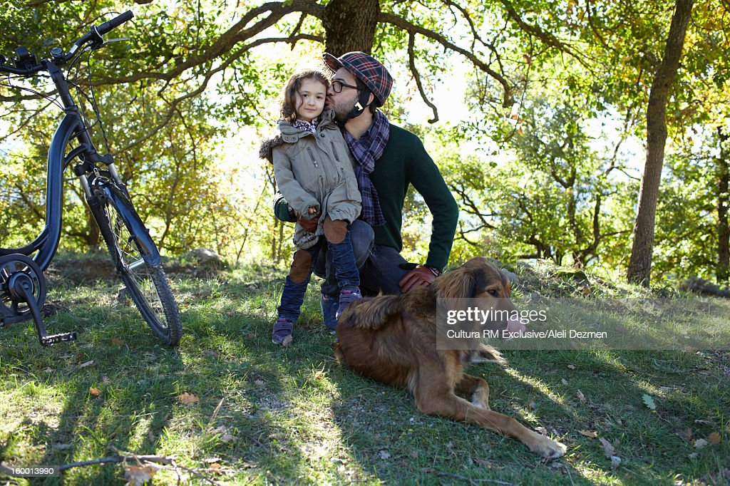 Father and daughter with dog in forest : Stock-Foto
