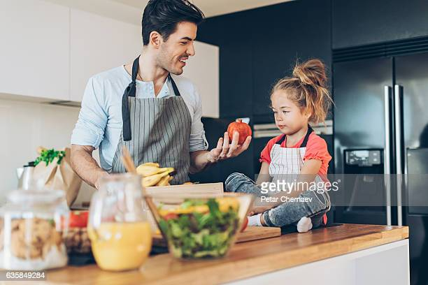 Father and daughter with organic food