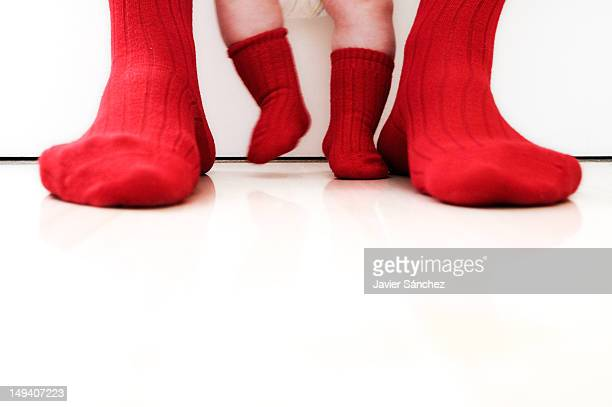 Father and daughter with red socks