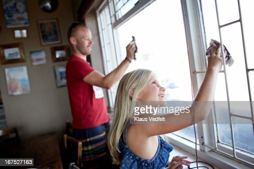 Father and daugther cleaning windows : Stock Photo