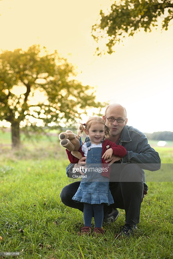Father and dautghter in sunset : Stock Photo