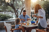 Father and dauther having mediterranean dinner on a terrace during summer vacation