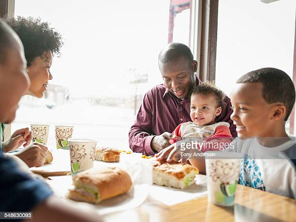 Father and family dining in restaurant