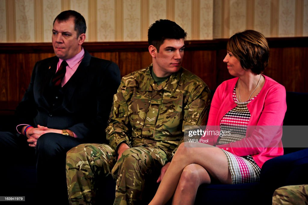 Father and former Grenadier Guardsman Duane Ashworth, brother of James and serving soldier Coran Ashworth and his mother Kerry Ashworth react as James Ashworth's citation is read out at a press conference at Buller Barracks on March 18, 2013 in Aldershot, England. Lance Corporal James Ashworth has been awarded the Victoria Cross in recognition of his 'extraordinary courage' while serving with the 1st Battalion The Grenadier Guards in Helmand province where he died last June.