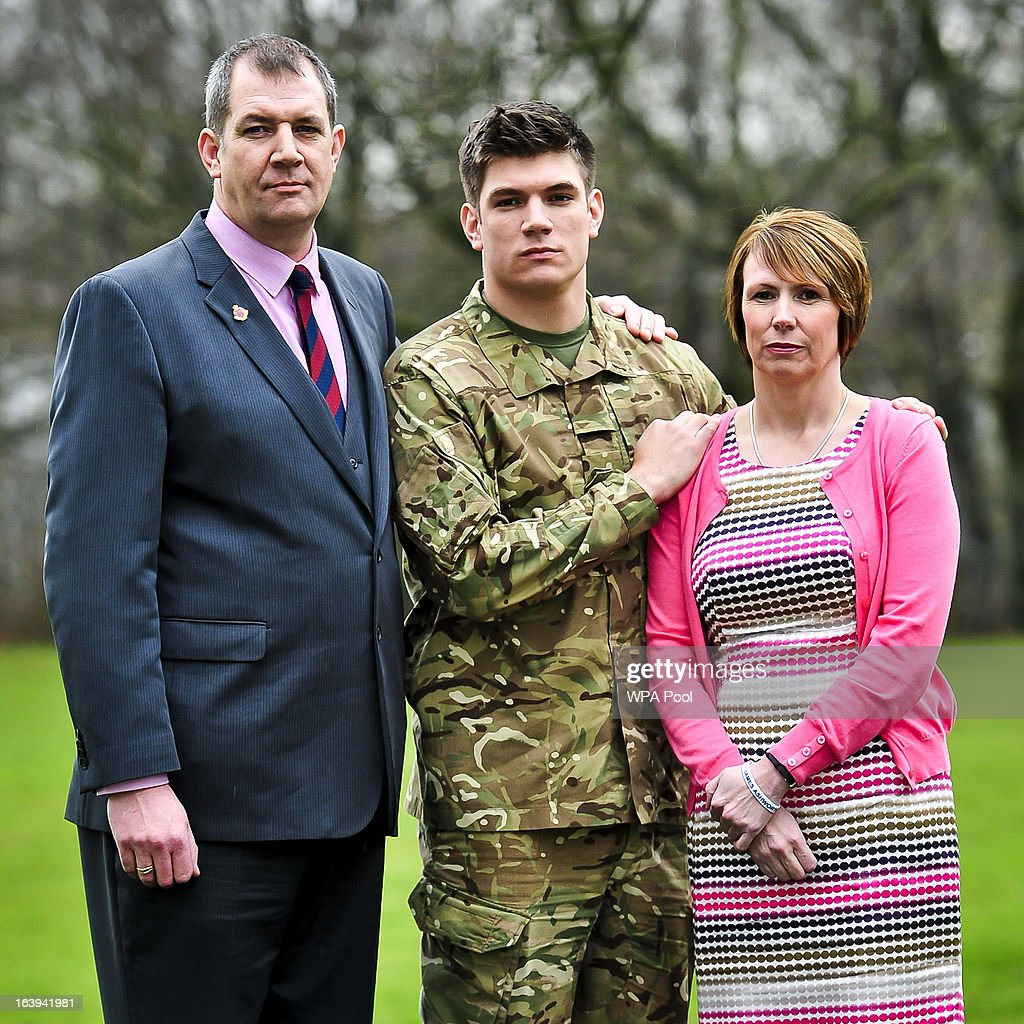 Father and former Grenadier Guardsman Duane Ashworth, serving soldier Coran Ashworth and mother Kerry Ashworth and brother of James are are seen as James Ashworthis awarded the Victoria Cros at a press conference at Buller Barracks on March 18, 2013 in Aldershot, England. Lance Corporal James Ashworth has been awarded the Victoria Cross in recognition of his 'extraordinary courage' while serving with the 1st Battalion The Grenadier Guards in Helmand province where he died last June.