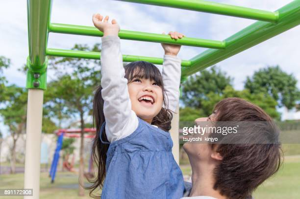 Father and girl playing in the park