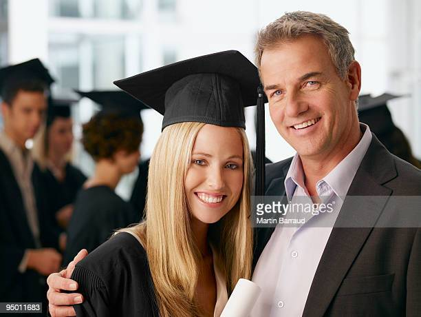 Father and graduate daughter hugging