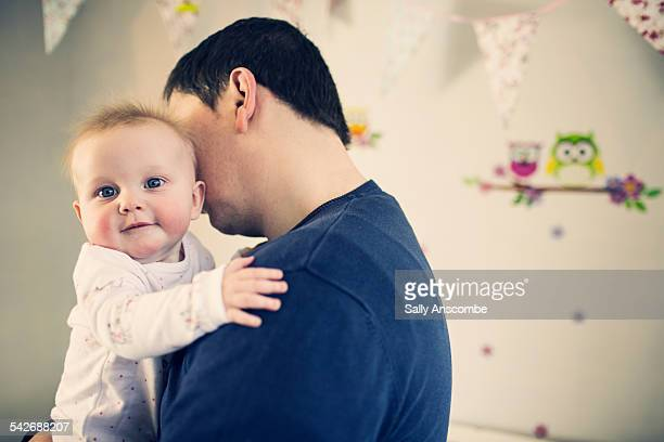 Father and happy baby girl