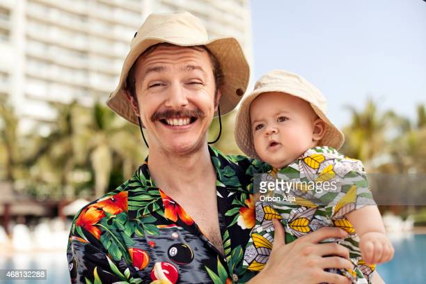 Father and his son with hawaian shirts
