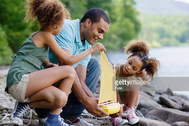 Father and Kids Playing on Lake Shore