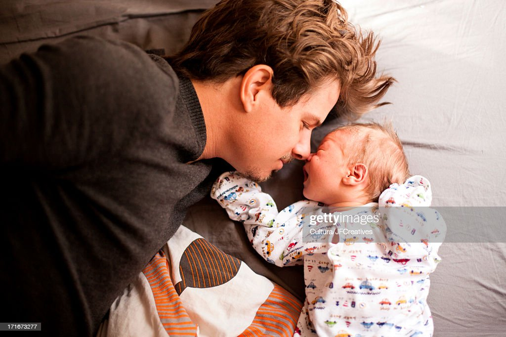 Father and newborn baby : Stock Photo
