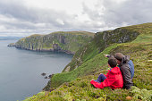 Father and son admires beauty landscape. Location Horn Head in Ireland co. Donegal