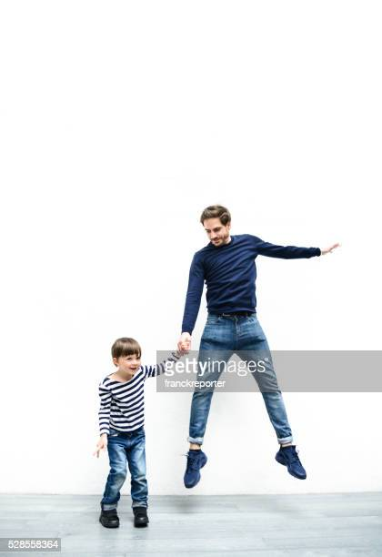 father and son against the white wall