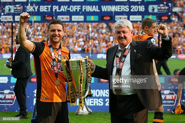 Father and son Alex Bruce and Steve Bruce manager of Hull City celebrate with the trophy after the Sky Bet Championship Play Off Final match between...