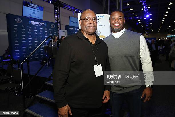 Father and son and former professional baseball players Ken Griffey Sr and Ken Griffey Jr visit the SiriusXM set at Super Bowl 50 Radio Row at the...