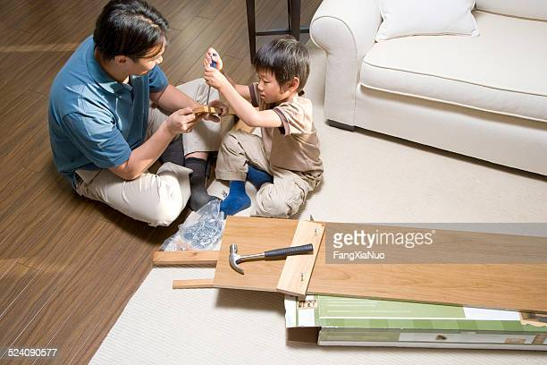 Father and Son Assembling Furniture