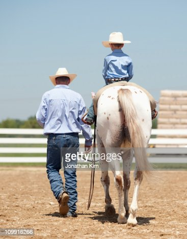 Father and son at a horse show.