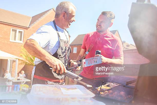 Father and son at the BBQ