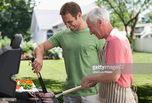 Father and son at the grill