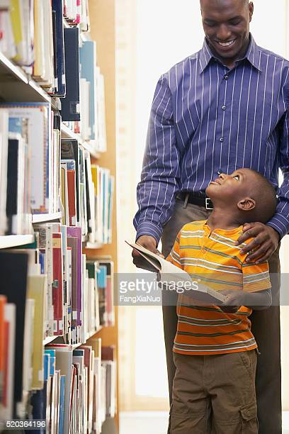 Father and son at the library