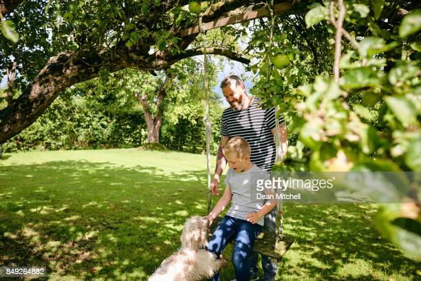 Father and son at the park with pet dog