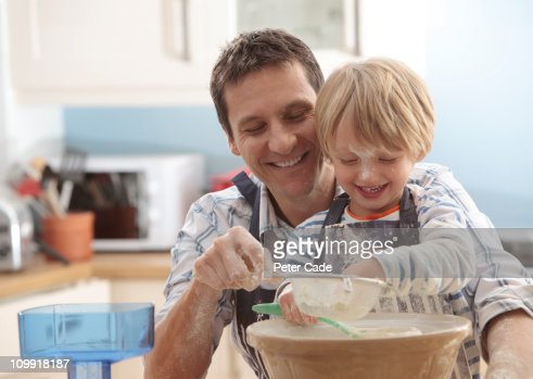 father and son baking together : Stock Photo