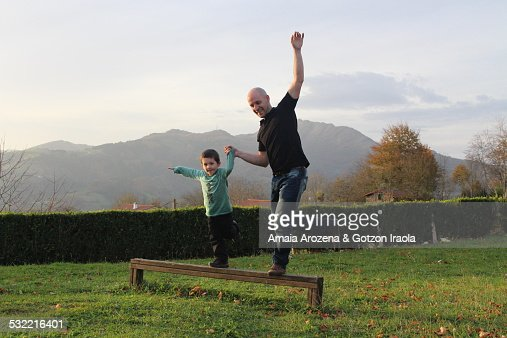 Father and son balancing