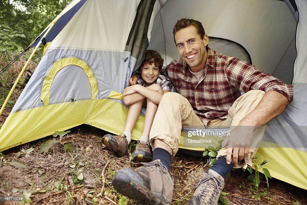 Father and son bonding while camping : Stock Photo