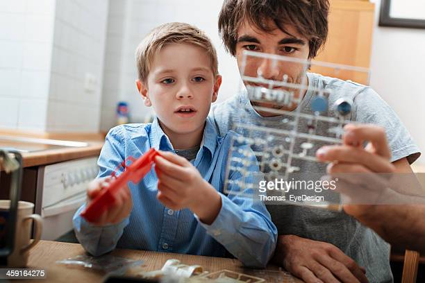 Father and son building model car