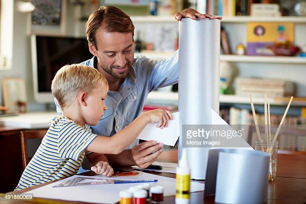 Father and son building rocket