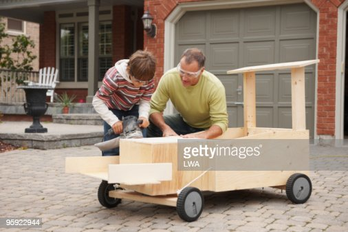 Father And Son Building Soap Box Car : Stock Photo