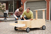 Father And Son Building Soap Box Car